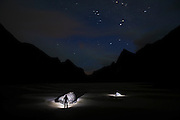Ethan Welty illuminates boulders by headlamp at Horseid Beach, Moskenesoya, Lofoten Islands, Norway.
