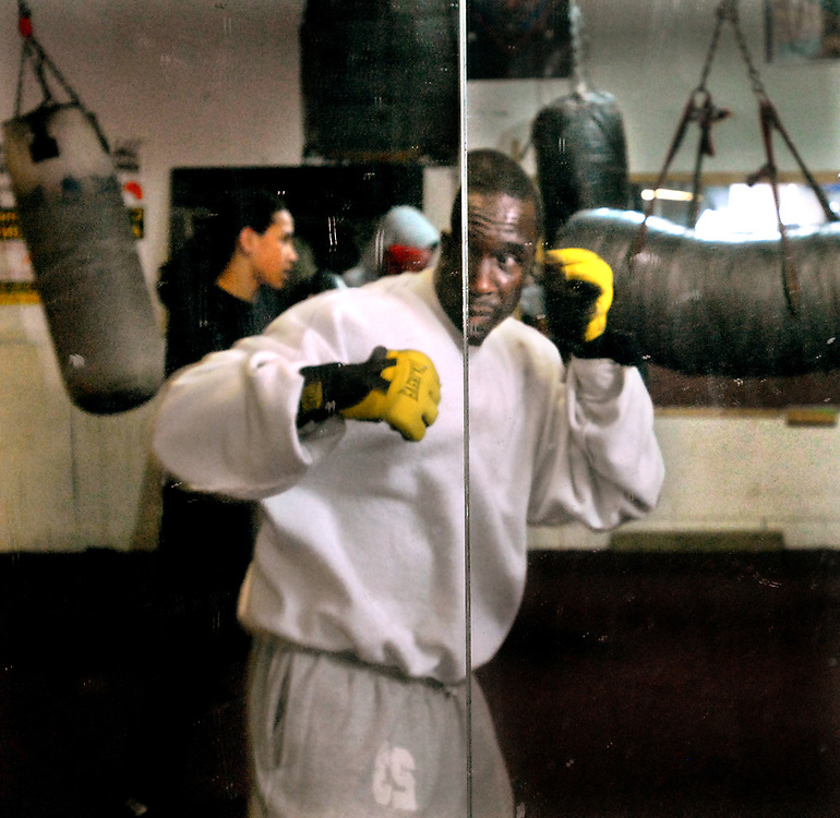 12/20/06 2Blackwell<br /> ML0323D<br /> New Haven Police Officer Russell Blackwell warms up by shadow boxing at Ring One in New Haven. Photo by Mara Lavitt