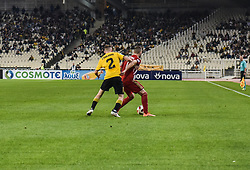 October 7, 2018 - Athens, Greece, Greece - AEK Athens'  Michalis Bakakis with Olympiakos' Kostas Fortounis seen in action during their Greek Super League soccer match at Olympic stadium. (Credit Image: © Dimitris Lampropoulos/SOPA Images via ZUMA Wire)