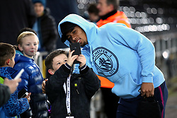 Manchester City's Gabriel Jesus takes a picture with young fans as he arrives at the stadium prior to the Premier League match at the Liberty Stadium, Swansea.