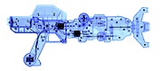 An X-ray of a toy gun. This gun has a number of motors to turn different parts, the gun also has a noise making system.