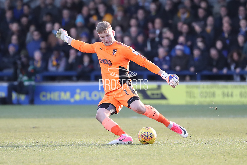 AFC Wimbledon goalkeeper George Long (1) clearing the ball during the EFL Sky Bet League 1 match between AFC Wimbledon and Bristol Rovers at the Cherry Red Records Stadium, Kingston, England on 17 February 2018. Picture by Matthew Redman.