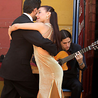 South America, Argentina, Buenos Aires. Tango Dancers on the streets of La Boca.