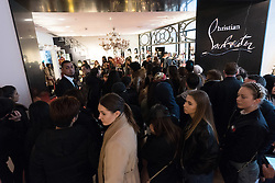 © Licensed to London News Pictures. 26/12/2016. Customers queuing for Christian Louboutin shoes in Selfridges store in Oxford Street for the start of the stores Boxing Day sales. London, UK. Photo credit: Ray Tang/LNP