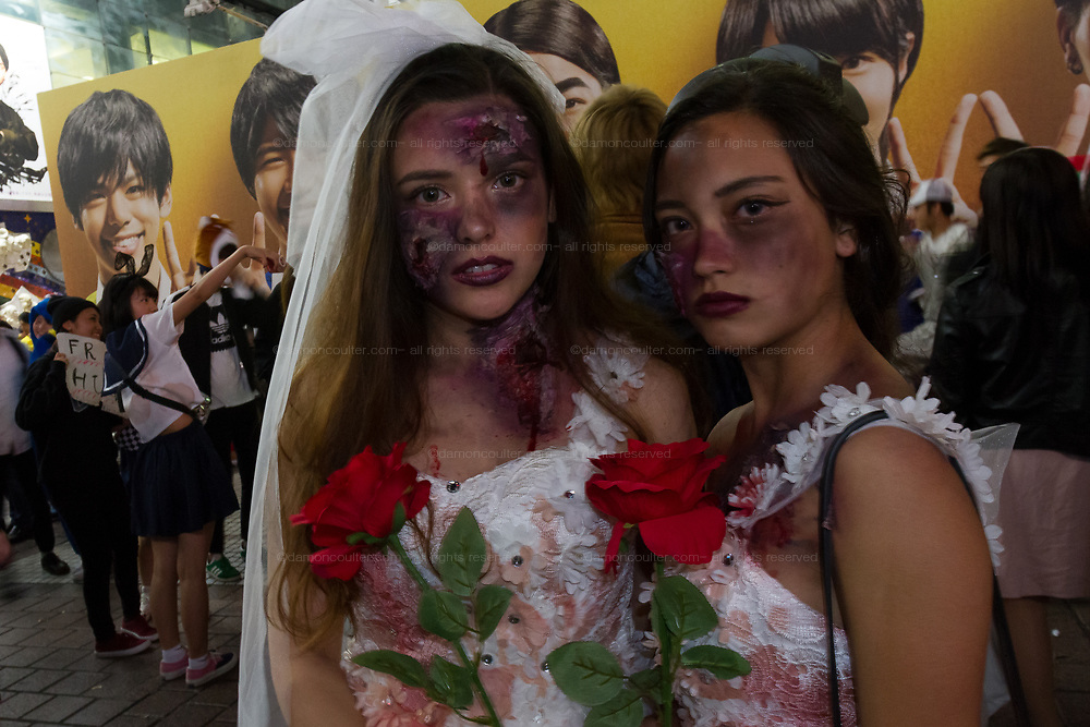 Two woman dressed as macabre brides during the Halloween celebrations Shibuya, Tokyo, Japan. Saturday October 27th 2018. The celebrations marking this event have grown in popularity in Japan recently. Enjoyed mostly by young adults who like to dress up, drink , dance and misbehave in parts of Tokyo like Shibuya and Roppongi. There has been a push back from Japanese society and the police to try to limit the bad behaviour.