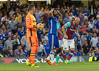 Football - 2016/2017 Premier League - Chelsea V West Ham United. <br /> <br /> Diego Costa of Chelsea holds his head in his hands in disbelief after not being awarded a penalty at Stamford Bridge.<br /> <br /> COLORSPORT/DANIEL BEARHAM