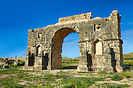 The Arch of Caracalla, built in 217 by the city's governor, Marcus Aurelius Sebastenus, to honour the emperor Caracalla and his mother Julia Domna.Volubilis Archaeological Site, near Meknes, Morocco .<br /> <br /> Visit our MOROCCO HISTORIC PLAXES PHOTO COLLECTIONS for more   photos  to download or buy as prints https://funkystock.photoshelter.com/gallery-collection/Morocco-Pictures-Photos-and-Images/C0000ds6t1_cvhPo<br /> .<br /> <br /> Visit our ROMAN ART & HISTORIC SITES PHOTO COLLECTIONS for more photos to download or buy as wall art prints https://funkystock.photoshelter.com/gallery-collection/The-Romans-Art-Artefacts-Antiquities-Historic-Sites-Pictures-Images/C0000r2uLJJo9_s0