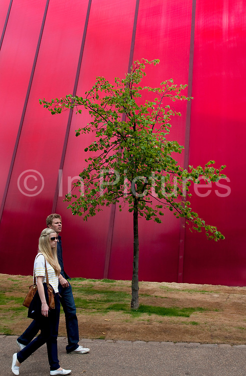 The Serpentine's 40th Anniversary. The Serpentine Gallery Pavilion is designed by world-renowned French architect Jean Nouvel. This 2010 Pavilion is the 10th commission in the Gallery's annual series, the world's first and most ambitious architectural programme of its kind. It will be the architect's first completed building in the UK. The red structure reflects the sky, has red glass to look through and provides space for people to come and relax. The design for the 2010 Pavilion is a contrast of lightweight materials and dramatic metal cantilevered structures. The entire design is rendered in a vivid red that, in a play of opposites, contrasts with the green of its park setting. In London, the colour reflects the iconic British images of traditional telephone boxes, post boxes and London buses.