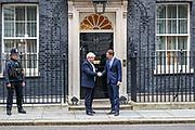 Britain's PM Boris Johnson (L) shakes hands with Austrian chancellor Sebastian Kurz at 10 Downing Street on Tuesday, Feb. 25, 2020. (Photo/Vudi Xhymshiti)
