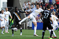 Swansea city's Michu battles for the ball with Fulham's Emmanuel Frimpong .Barclays Premier league, Swansea city v Fulham at the Liberty Stadium in Swansea, South Wales on Sunday 19th May 2013. pic by Andrew Orchard,  Andrew Orchard sports photography,