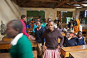 Children from Kibera slum attend the local school where they learn English.  The school consists of 6 teachers with approximately 60 children in each class.  Undugu Society of Kenya (USK) is an NGO who run various programmes help the school and pupils with books and other materials.