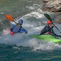 Kayakers Paul Manning-Hunter and David Manning paddles through rapids in the Kananaskis River near Calgary, Alberta, Canada.