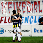 Fenerbahce's Gokhan Gonul celebrate his goal with team mate during their Turkish SuperLeague Derby match Trabzonspor between Fenerbahce at the Avni Aker Stadium at Trabzon Turkey on Sunday, 17 February 2013. Photo by TURKPIX