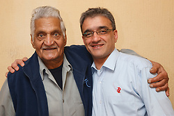 Son with elderly south Asian father.