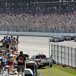 April 17, 2011; Talladega, AL, USA; NASCAR Sprint Cup Series drivers Jeff Gordon (24), Mark Martin (5), Clint Bowyer (33), Kevin Harvick (29), Jimmie Johnson (48) and Dale Earnhardt Jr. (88) make the final turn during the Aarons 499 at Talladega Superspeedway.   Mandatory Credit: Derick E. Hingle