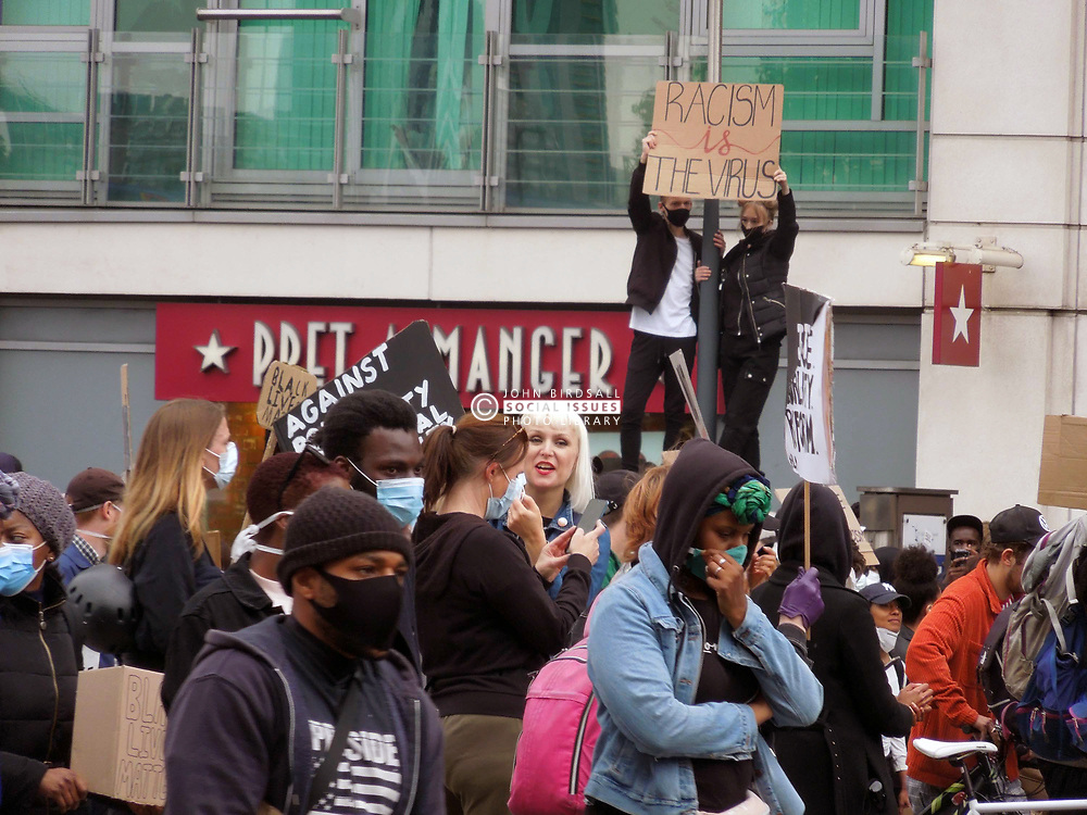 Black Lives Matter protest following police killing of George Floyd in Minneapolis USA. London UK June 2020. The demo took place during Coronavirus lockdown