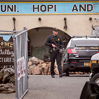 Armed New Mexico State Police Officers barricade The Nugget Gallery in Gallup Tuesday.
