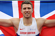 Andrew  Pozzi celebrating with a United Kingdom flag after winning the Men's 110m Hurdles race which qualifies him to compete in the 2016 Rio Olympics.The British Championships 2016, athletics event at the Alexander Stadium in Birmingham, Midlands  on Sunday 26th June 2016.<br /> pic by John Patrick Fletcher, Andrew Orchard sports photography.