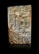 Pictures & images of the North Gate Hittite sculpture stele men hunting. 8th century BC.  Karatepe Aslantas Open-Air Museum (Karatepe-Aslantaş Açık Hava Müzesi), Osmaniye Province, Turkey. Against black background