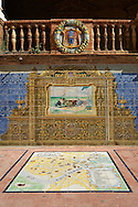 The Seville tiled Alcove along the walls of the Plaza de Espana in Seville built in 1928 for the Ibero-American Exposition of 1929, Seville Spain . The Royal Alcázars of Seville (al-Qasr al-Muriq ) or Alcázar of Seville, is a royal palace in Seville, Spain. It was built by Castilian Christians on the site of an Abbadid Muslim alcazar, or residential fortress.The fortress was destroyed after the Christian conquest of Seville The palace is a preeminent example of Mudéjar architecture in the Iberian Peninsula but features Gothic, Renaissance and Romanesque design elements from previous stages of construction. The upper storeys of the Alcázar are still occupied by the royal family when they are in Seville. <br /> <br /> Visit our SPAIN HISTORIC PLACES PHOTO COLLECTIONS for more photos to download or buy as wall art prints https://funkystock.photoshelter.com/gallery-collection/Pictures-Images-of-Spain-Spanish-Historical-Archaeology-Sites-Museum-Antiquities/C0000EUVhLC3Nbgw <br /> .<br /> Visit our MEDIEVAL PHOTO COLLECTIONS for more   photos  to download or buy as prints https://funkystock.photoshelter.com/gallery-collection/Medieval-Middle-Ages-Historic-Places-Arcaeological-Sites-Pictures-Images-of/C0000B5ZA54_WD0s
