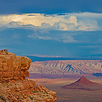 A colorful sandstone butte rises in Valley of the Gods, Utah, formerly part of Bears Ears National Monument.  Cedar Mesa is in the foreground.