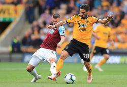 Wolverhampton Wanderers' Joao Moutinho (right) and Burnley's Johann Gudmundsson battle for the ball