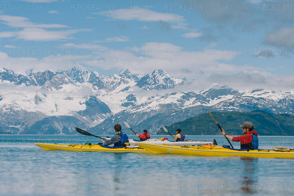 Kayakers in the West Arm of Alaska's Glacier Bay National Park. Margerie Glacier can be seen in the distance. Photo © Robert Zaleski / rzcreative.com