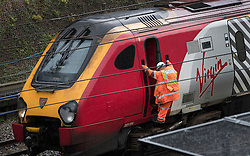 © Licensed to London News Pictures. 16/09/2016. Watford, UK. A Network Rail incident officer climbs down from a train that rescued stranded passengers. A landslide has derailed a train inside the Leavesden tunnel near Watford, following heavy rainfall over night. A train is stuck in the tunnel. Photo credit: Peter Macdiarmid/LNP