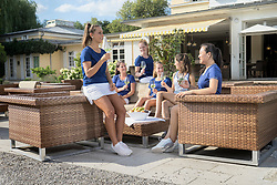 Group of women drinking and relaxing in front of tennis club house, Bavaria, Germany