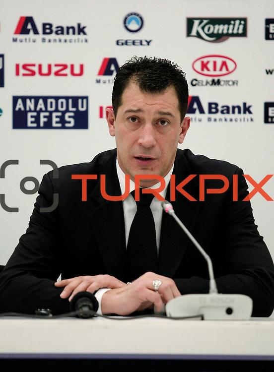 Anadolu Efes's coach Ufuk Sarica during their Turkish Basketball League match Anadolu Efes between Turk Telekom at Arena in Istanbul, Turkey, Wednesday, January 04, 2012. Photo by TURKPIX