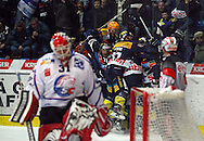 Kloten Flyers forward Victor Stancescu (hidden) celebrates with his teammates after scoring the winning goal to the score of 3-2 against ZSC Lions goaltender Ari Sulander (front) during overtime in the ice hockey game five of the Swiss National League A Playoff Quarterfinal between Kloten Flyers and ZSC Lions held at the Kolping Arena in Kloten, Switzerland, Tuesday, March 8, 2011. (Photo by Patrick B. Kraemer / MAGICPBK)