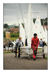 470 Class European Championships Largs - Day 6..Boats coming ashore on the championship slipway.