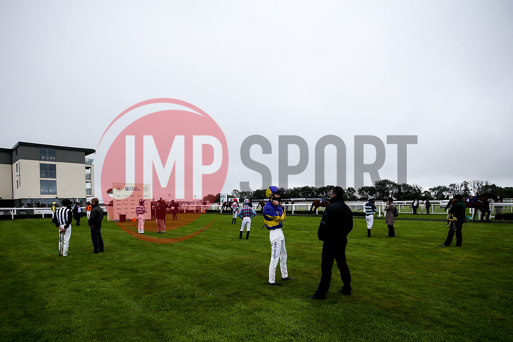 Jockey's and trainers in the parade ring at Bath Racecourse - Mandatory by-line: Robbie Stephenson/JMP - 19/08/2020 - HORSE RACING - Bath Racecourse - Bath, England - Bath Races