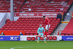 Cyrus Christie of Nottingham Forest powers a header forwards - Mandatory by-line: Nick Browning/JMP - 29/11/2020 - FOOTBALL - The City Ground - Nottingham, England - Nottingham Forest v Swansea City - Sky Bet Championship