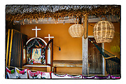 SHOT 12/9/16 1:53:33 PM - A set of tiny capilla on the front porch of a home near Rancho Viejo, Mexico. The capillas are common along the roads and highways of Mexico which is heavily Catholic and are often dedicated to certain patron saints or to the memory of a loved one that has passed away. Often times they contain prayer candles, pictures, personal artifacts or notes. (Photo by Marc Piscotty / © 2016)