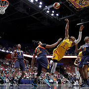 iUNCASVILLE, CONNECTICUT- JUNE 5:   Tiffany Mitchell #3 of the Indiana Fever falls back after having her shot blocked by Alex Bentley #20 of the Connecticut Sun resulting in a jump ball during the Indiana Fever Vs Connecticut Sun, WNBA regular season game at Mohegan Sun Arena on June 3, 2016 in Uncasville, Connecticut. (Photo by Tim Clayton/Corbis via Getty Images)