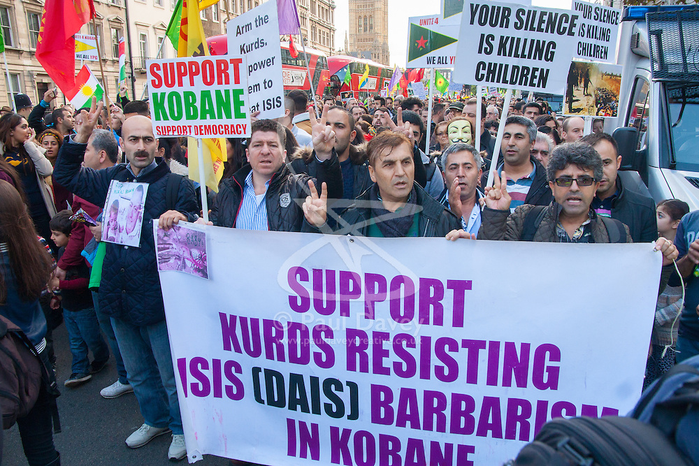London, October 11th 2014. Thousands of protesters from the UK's Kurdish community demonstrate in London against the delay in assisting the people of the Syrian city of Kobane in their fight against ISIS. They also accuse Turkey, with whom the Kurds have had a long-running insurgency of siding with the Islamic State by doing nothing to help Kurds in Kobane. PICTURED: Kurdish protesters ask for western support in their fight to save the Syrian city of Kobane from ISIS.