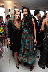 Left to right, PRINCESS BEATRICE OF YORK and GOGA ASHKENAZI at The Reuben Foundation and Virgin Unite Haiti Fundraising dinner held at Altitude 360 in Millbank Tower, London on 26th May 2010.