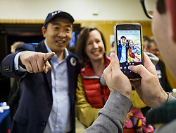 April 28, 2019 - Des Moines, Iowa, U.S - ANDREW YANG poses for pictures with a woman and her baby before a Town Hall event in Des Moines. Yang, an entrepreneur, is one of 20 Democrats running for the Democratic nomination for the US Presidency in 2020. Iowa hosts the the first election event of the presidential election cycle. The Iowa Caucuses will be on Feb. 3, 2020. (Credit Image: © Jack Kurtz/ZUMA Wire)