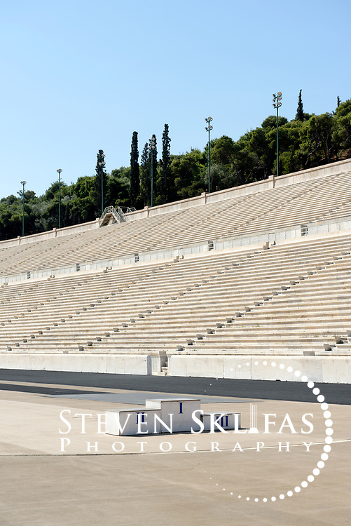 Athens. Greece. View of the winners podium on the running tracking of the stadium. The Panathenaic (Kallimarmaro) stadium was used for the first international Olympic games of the modern era in 1896.  The completely marble stadium occupies the exact site of the original, built in 330BC which was used for the ancient Panathenaic games (part of the larger religious festival, the Panathenaia).