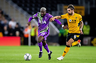 Tanguy Ndombele of Tottenham Hotspur battles for possession during the EFL Cup match between Wolverhampton Wanderers and Tottenham Hotspur at Molineux, Wolverhampton, England on 22 September 2021.
