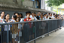July 23, 2017 - Beijin, Beijin, China - Beijing, CHINA-July 23 2017: (EDITORIAL USE ONLY. CHINA OUT) Tourists queue up to enter the Peking University in Beijing, July 23rd, 2017. Many visitors flock to Peking University during summer holiday. (Credit Image: © SIPA Asia via ZUMA Wire)