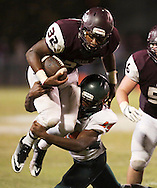 Sherman's Brent Wilson is stopped by Jason Iheme after a short gain during overtime in a game between Sherman High and Naaman Forest on Friday, Sept. 16, 2016 at Bearcat Stadium in Sherman. It was Sherman's homecoming game.  (Kevin Bartram/www.buzzzphotos.com)