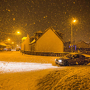 A car stuck in the snow on Main Street, Stonehouse, South Lanarkshire, during the late afternoon. Picture Robert Perry 8th Jan 2015<br /> <br /> Must credit photo to Robert Perry<br /> FEE PAYABLE FOR REPRO USE<br /> FEE PAYABLE FOR ALL INTERNET USE<br /> www.robertperry.co.uk<br /> NB -This image is not to be distributed without the prior consent of the copyright holder.<br /> in using this image you agree to abide by terms and conditions as stated in this caption.<br /> All monies payable to Robert Perry<br /> <br /> (PLEASE DO NOT REMOVE THIS CAPTION)<br /> This image is intended for Editorial use (e.g. news). Any commercial or promotional use requires additional clearance. <br /> Copyright 2014 All rights protected.<br /> first use only<br /> contact details<br /> Robert Perry     <br /> 07702 631 477<br /> robertperryphotos@gmail.com<br /> no internet usage without prior consent.         <br /> Robert Perry reserves the right to pursue unauthorised use of this image . If you violate my intellectual property you may be liable for  damages, loss of income, and profits you derive from the use of this image.