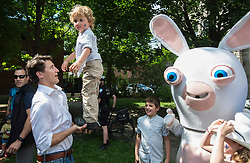 Prime Minister Justin Trudeau balances his son Hadrian as his older brother Xavier and his sister Ella-Grace look on at a street party for the Fete National du Quebec, Saturday, June 24, 2017 in Montreal, Canada. Photo by Paul Chiasson/CP/ABACAPRESS.COM