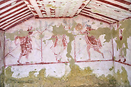 """Underground Etruscan tomb Known as """"Tomba Massimo Pallottino no 3713"""". A single chamber with double sloping ceiling decorated. On the back wall are a painted dancing harpist, and couples dancing holding dinking cups.  Circa 580 BC. Excavated 1962, Etruscan Necropolis of Monterozzi, Monte del Calvario, Tarquinia, Italy. A UNESCO World Heritage Site. .<br /> <br /> Visit our ETRUSCAN PHOTO COLLECTIONS for more photos to buy as buy as wall art prints https://funkystock.photoshelter.com/gallery-collection/Pictures-Images-of-Etruscan-Historic-Sites-Art-Artefacts-Antiquities/C0000GgxRXWVMLyc"""