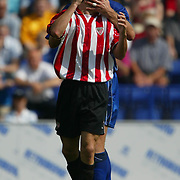 Leicester City's Matt Elliott grabs Athletic Bilboa's no. 9 after being elbowed by the Spaniard which resulted in him being sent off