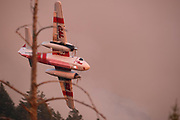 """CalFire Air Ops battle to secure a fireline along Old Lawley Toll Road and Highway 29 above Calistoga in Napa Valley, California on September 30, 2020 as the massive """"Glass Fire"""" burns through the region. Despite heroic  efforts of air and ground crews the fire jumped the line the next morning."""