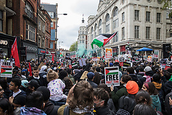 London, UK. 15th May, 2021. Tens of thousands of people protest outside the Israeli embassy following the March for Palestine on Nakba Day. The march, which was organised by Palestine Solidarity Campaign (PSC), CND, Friends of Al Aqsa, Muslim Association of Britain, Palestinian Forum in Britain and Stop The War Coalition, took place in protest against Israeli air raids on Gaza, the deployment of Israeli forces to the Al-Aqsa mosque during Ramadan and attempts to forcibly displace Palestinian families from the Sheikh Jarrah neighbourhood of East Jerusalem and speakers called for an end to Israeli support for and arms sales to Israel.