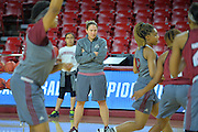 March 17, 2016: New Mexico State Aggies associate head coach Tamara Inoue watches her team during the first practice day of the 2016 NCAA Division I Women's Basketball Championship first round in Tempe, Ariz.